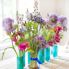 Beautiful spring flowers on wooden table.
