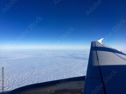 canvas print picture Flugzeug über den Wolken