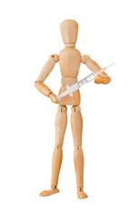 Wooden mannequin holding syringe