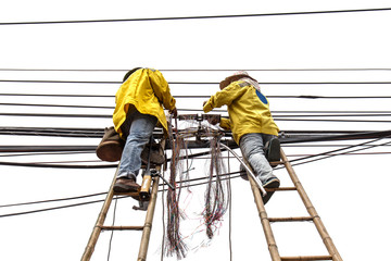 worker on bamboo ladder is repairing telephone line