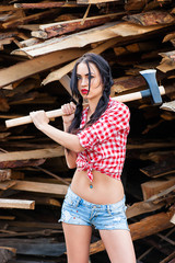 sexy woman in plaid shirt with axe