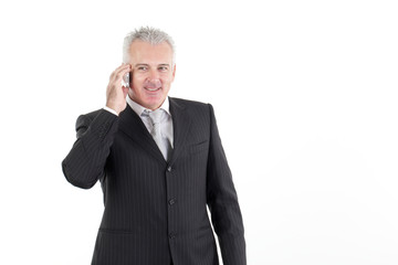 adult businessman talking to mobile