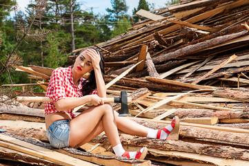tired woman is sitting on wooden boards