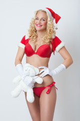 beautiful and sexy woman dresses as a sexy santa claus