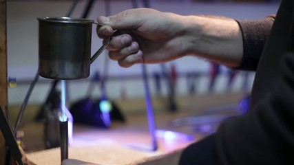 Jeweler warming can with acid in jewelry workshop