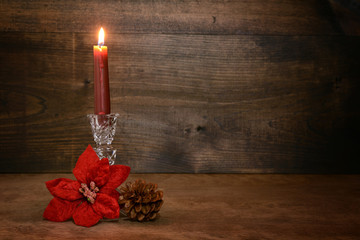 candle with poinsettia flower