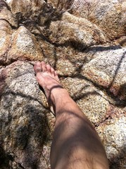 my foot stepping on a rock