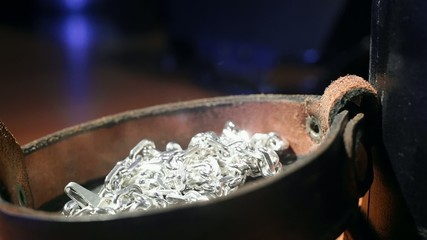 Put silver necklace chain into vintage jewelry velvet box