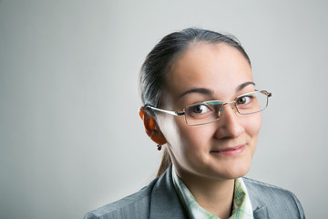 Confident woman looking through her spectacles