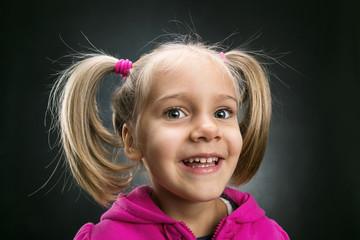 Little girl in rose jacket smiling