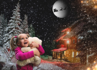 Cute small girl  with toy beart outside