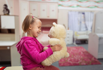 Small cute girl  with toy beart