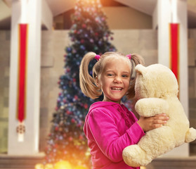 Cute small girl  with toy bear