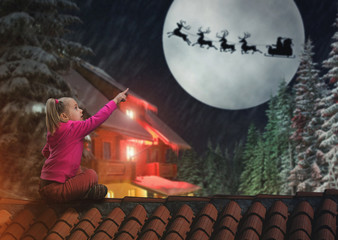 Girl on the roof in The Christmas eve