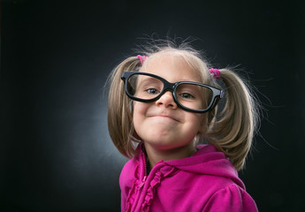Little girl in funny big spectacles