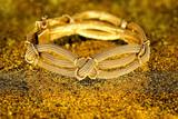 Fototapeta gold bracelet
