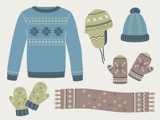 Winter knitted clothes: sweater, hats, mittens, scarf