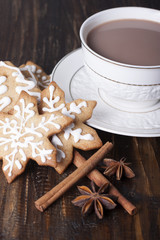 Christmas gingerbread cookies and cocoa in a white cup.