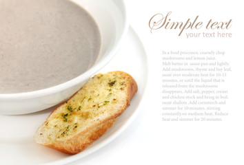 Creamy white mushroom soup with croutons