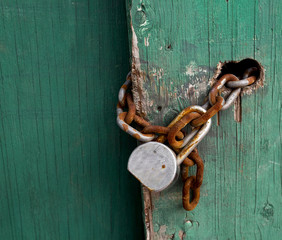 Rusty Chain and Pad Lock With Room for Your type.