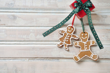 sweet homemade cookies with gift for Christmas on white old wood