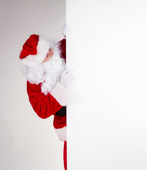 Santa Claus with blank board for text