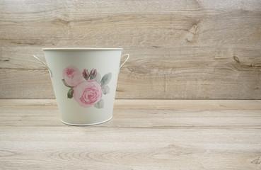 Romantic flower pot on wooden background