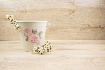 Romantic pot with flower on wooden background