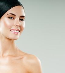 young beautiful woman smiling. perfect skin