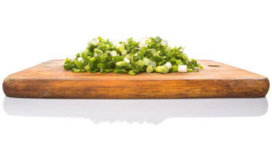Spring onion or scallions on wooden cutting board