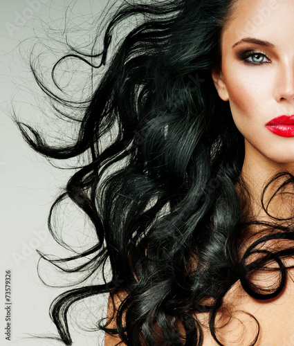 brunette with long hair and red lipstick - 73579326