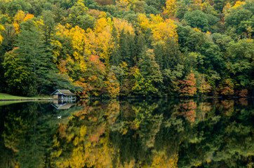 Boathouse Along Lake in Fall