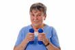 canvas print picture - Seniorin trainiert mit Hanteln - Senior woman exercising with du