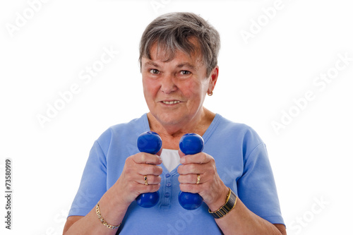 canvas print picture Seniorin trainiert mit Hanteln - Senior woman exercising with du