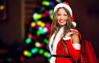 Girl dressed for Christmas holding shopping bags