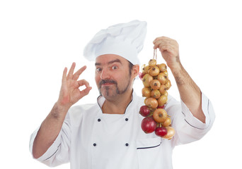 Playful Chef with bunch of onions