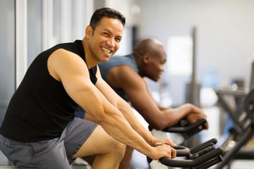 two men doing indoor biking