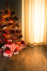 Christmas eve with colorful tree and gifts
