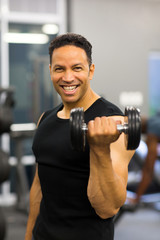 athletic man excising with dumbbells