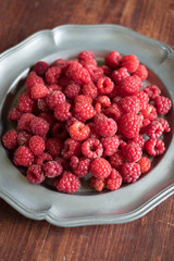 Ripe juicy raspberry in a bowl