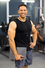 muscular male gym trainer