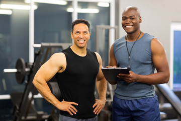 african american fitness instructor with client