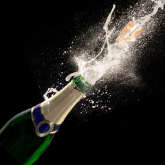 Champagne explosion on black background