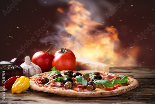 Fotobehang Koken Delicious italian pizza served on wooden table
