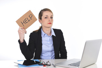 young businesswoman holding help sign overworked at office