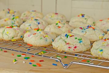 cookies with sprinkles on cooling rack