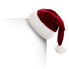 Weihnachtsmütze auf einem Blatt Papier