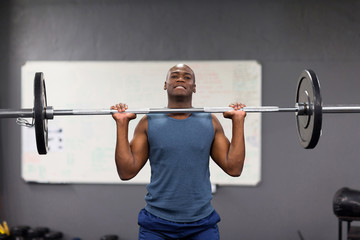 african american man lifting barbell