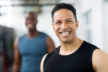 mid age male gym trainer closeup portrait