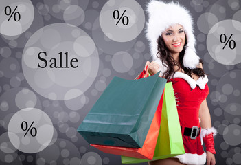 beautiful sexy girl wearing santa claus clothes with color bag
